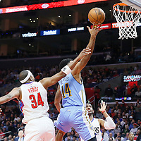 24 February 2016: Denver Nuggets guard Gary Harris (14) goes for the layup past Los Angeles Clippers forward Paul Pierce (34) and Los Angeles Clippers guard Chris Paul (3) during the Denver Nuggets 87-81 victory over the Los Angeles Clippers, at the Staples Center, Los Angeles, California, USA.