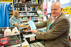 © Licensed to London News Pictures. 20/07/2019. Builth Wells, Powys, Wales, UK. Des Parkinson visits local businesses in Builth Wells High Street in Powys. The Brexit Party, with  Brecon & Radnorshire constituency candidate Des Parkinson,  bring their campaign to the small Welsh market town of Builth Wells in Powys, UK. in a bid to win a seat in the forthcoming Brecon & Radnorshire constituency by-election on the 1st August 2019. The Brexit Party was founded by former UKIP economics spokeswoman, Catherine Blaiklock in January 2019, and is led by Nigel Farage. The Brexit party has 29 Members of the European Parliament (MEPs) and four Welsh Assembly Members. The party's first major electoral success was winning the 2019 European Parliament election in the United Kingdom after four months in existence. Photo credit: Graham M. Lawrence/LNP