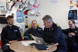 The Duke of Cambridge (centre) in the briefing room with the crews as he starts his final shift with the East Anglian Air Ambulance based at Marshall Airport near Cambridge.