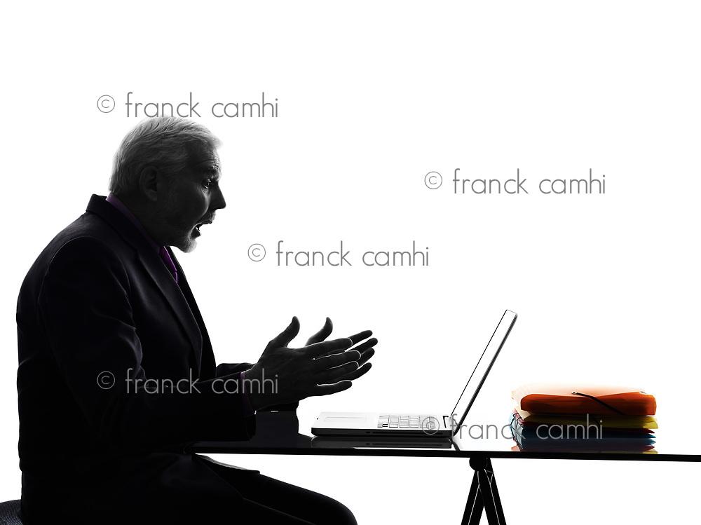 One Caucasian Senior Business Man computing laptop surprised Silhouette White Background