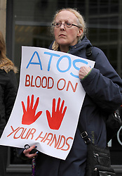 "© Licensed to London News Pictures. 19/02/2014. Manchester, UK. People protest in Manchester against ATOS Healthcare who carry out millions of ""fit-for-work"" tests for sick and disabled benefit claimants on behalf of the UK Government. It is reported that the Government will terminate the contract with ATOS. Photo credit : Steve Purcell/LNP"