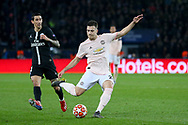 Manchester United Defender Diogo Dalot shoots at goal during the Champions League Round of 16 2nd leg match between Paris Saint-Germain and Manchester United at Parc des Princes, Paris, France on 6 March 2019.