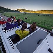Teten Science Schools tour participants watch a herd of elk forage in the early morning hours. (Greg Peck, Matthew Bart, Sean Baker, Maura Bushior, Katie-Cloe Stock, Tracy Logan)