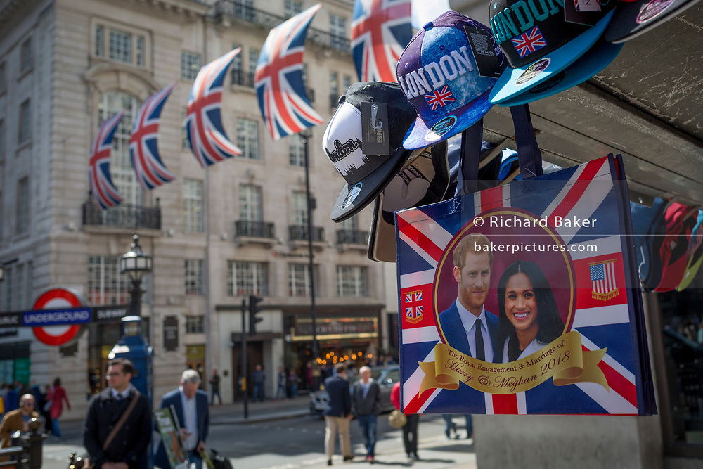 With weeks to go before the royal wedding, the faces of Prince Harry and Meghan Markle adorn merchandise that hangs from a tourist trinket kiosk in Piccadilly Circus, on 1st May, in London, England.