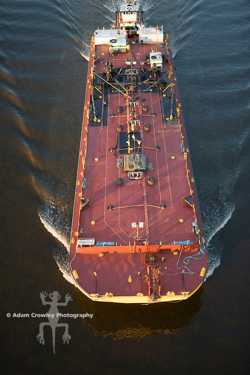 Barge travels under the Ben Franklin Bridege as it moves up the Delaware River