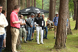 England's Aaron Rai line up a shot behind a tree on the 13th hole during day two of the 2018 BMW PGA Championship at Wentworth Golf Club, Surrey.