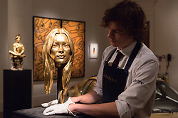 © Licensed to London News Pictures. 12/10/2018. London, UK. A gold of model Kate Moss titled Song Of The Siren by artist Marc Quinn with an estimate of £300,000 – 400,000 is on show as part of Sotheby's auction dedicated to all things gold. Photo credit: Ray Tang/LNP