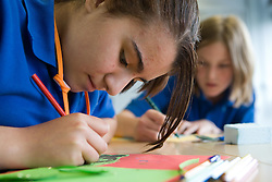 Secondary School girls designing a motions mechanism in a Technology class,