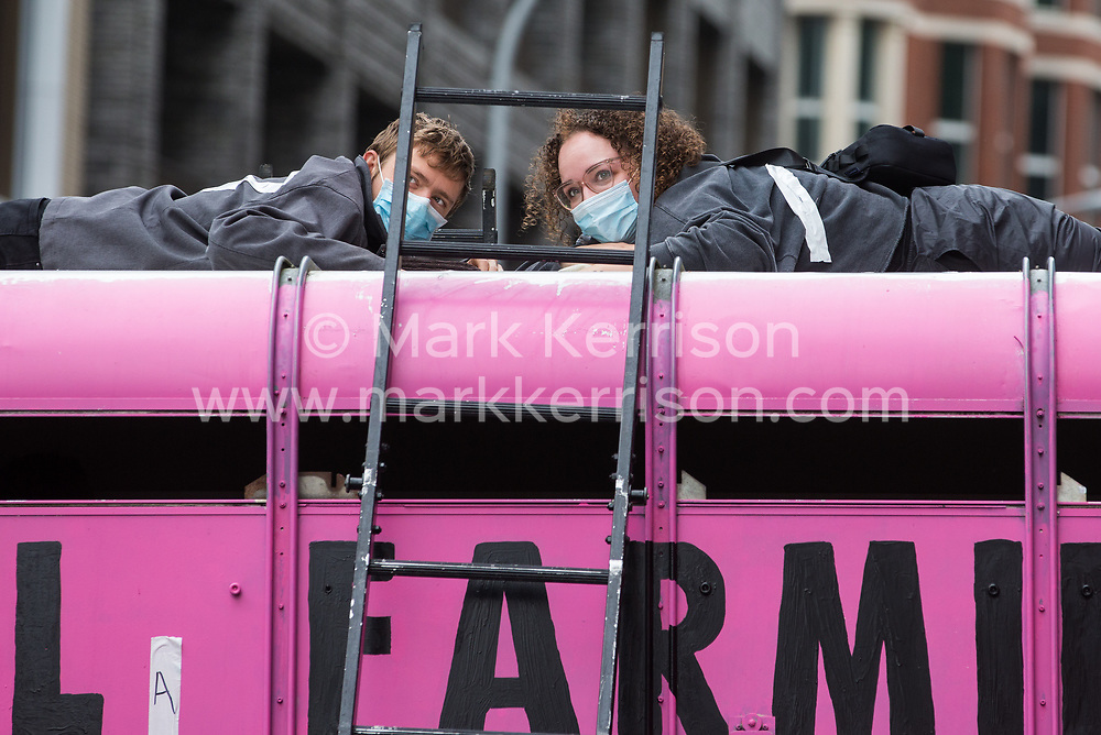 London, UK. 3rd September, 2020. Animal rights activists from Animal Rebellion are pictured glued to the top of and inside a truck in order to blockade the Department of Health and Social Care. Animal Rebellion activists are protesting in solidarity with victims of the global food system and to demand that the UK transitions to a sustainable plant-based food system.