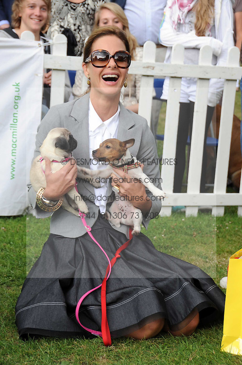 TRINNY WOODALL and puppies at the Macmillan Dog Day in aid of Macmillan Cancer Support held at the Royal Hospital Chelsea, London on 8th July 2008.<br /><br />NON EXCLUSIVE - WORLD RIGHTS