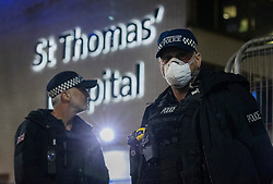 © Licensed to London News Pictures. 06/04/2020. London, UK. A police officer wears a facemask as he stands guard outside St Thomas' Hospital in central London where British Prime Minster Boris Johnson, who has contracted COVID-19, has been admitted to the intensive care unit after his conditioned worsened. The United Kingdom has started a third week of lockdown in an attempt to halt the spread of the coronavirus Covid-19. Photo credit: Peter Macdiarmid/LNP