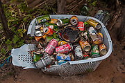 Basket of old soda cans sold to tourists that walked in to the Queimada dos Britos. Tourism is reaching the quiet life of Queimada dos Britos which is well received when the visitors walk in. Locals keep a stock of drinks that they sell to tourists as a way to make some money that allows them to buy some necessary products like clothes, coffee and rice. The downturn is that more and more agencies from nearby cities are bringing tourists into the park on motor vehicles that on the locals view are affecting environmentally the park and their peaceful life. But not only their life is threaten by the tourists and the sand. The Brazilian Institute of the Environment and Natural Resources (IBAMA) is planning to remove them since they live in a National Park. The residents refuse to move since many of them were born there and lived all their lives in the Queimada. They claim that more than a threat they are a protection to the Lençois do Maranhão.