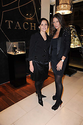 Left to right, TATIANA ANATOLY and LULU KENNEDY at a party for TACH jewellery held at Tach, 13 Grafton Street, London on 10th December 2009.