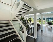 Architecture, open space of a modern house, <br /> living room view from stair