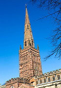 Steeple spire tower of Holy Trinity church against blue sky, Coventry, England, UK