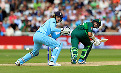 Pakistan's Imam-ul-Haq (right) hits the boundry during the ICC Cricket World Cup group stage match at Trent Bridge, Nottingham.