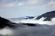 high mountain view with clouds between Andorra and France at Pas de la Casa