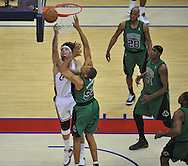 Anderson Varejao tries to control a rebound against P.J. Brown of Boston.