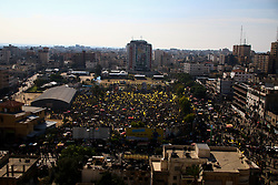 November 20, 2018 - Tens of thousands of Palestinians commemorate the 14th anniversary of the death of the Palestinian leader and founder of the Fatah movement, Yasser Arafat, in the Saraya Square in Gaza City. In the 1950s Arafat had joined a group of Palestinian nationalists in the founding of the Palestinian National Liberation Movement (Fateh). He was elected chairman of the Executive Committee of the Palestine Liberation Organization (PLO) in 1969, and became the first president of the Palestinian Authority since its establishment in 1994, following the 1993 signing of the Oslo Accords between the PLO and Israel. He has left behind a legacy of struggle and resistance against the Israeli occupation, but he has also been criticised for the signing of the Oslo Accords and the implications of the agreement for the Palestinian issue. Arafat died on 11 November 2004 after suffering from a sudden health deterioration while under Israeli military siege in his presidential headquarters in Ramallah (Credit Image: © Ahmad Hasaballah/IMAGESLIVE via ZUMA Wire)