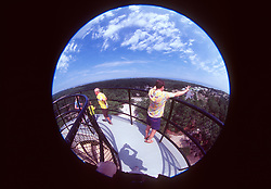 Visitors take in the view from a WWII-vintage observation tower at Cape Henlopen State Park in Rehoboth Beach, Del., Tuesday, Aug. 20, 2019. Military personnel during the 1940s watched the waters of the Atlantic Ocean for enemy vessels. (Photo by D. Ross Cameron)