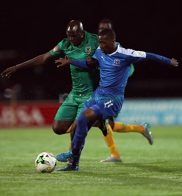 Abia Nale of Maritzburg Utd holds off Musa Bilankulu of Golden Arrows during the 2016 Premier Soccer League match between Maritzburg Utd and Golden Arrows held at the Harry Gwala Stadium in Pietermaritzburg, South Africa on the 28th October 2016<br /> <br /> Photo by:   Steve Haag / Real Time Images