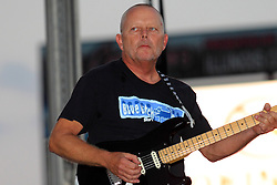 20 September 2014:   Burl Torner.<br /> <br /> Marc Boon and the Unknown Legends perform at the Chris Brown Benefit Concert at the Corn Crib Stadium, Normal Illinois.  The band is comprised of 8 musicians: Marc Boon - front man and lead guitar, Jeff Young - drums, Ray Wiggs- keyboards, Aaron Garcia - trumpet-percussion-vocals, Burl Torner - guitar, Russell Zehr - saxaphone-guitar-keyboards-vocals, Chris Briggs - bass-vocals-keyboard, Jerry Abner - keyboards,