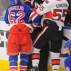 April 14, 2012: New York Rangers left wing Carl Hagelin (62) and Ottawa Senators defenseman Sergei Gonchar (55) slam into referee Stephen Walkom during the second period of Game 2 of the NHL Eastern Conference Quarter-finals between the Ottawa Senators and New York Rangers at Madison Square Garden in New York, N.Y.