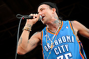 Yelawolf performing on Warped Tour at Verizon Wireless Amphitheater in St. Louis, Missouri on August 3, 2011. © Todd Owyoung.