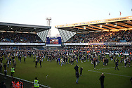 Millwall fans invade the pitch after full time after their team win match 1-0.. The Emirates FA Cup 5th round match, Millwall v Leicester City at The Den in London on Saturday 18th February 2017.<br /> pic by John Patrick Fletcher, Andrew Orchard sports photography.