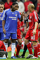 Photo: Paul Thomas.<br /> Liverpool v Chelsea. The FA Barclays Premiership. 19/08/2007.<br /> <br /> Didier Drogba of Chelsea has words to Dirk Kuyt as Fernando Torres (Ground) gets treatment.