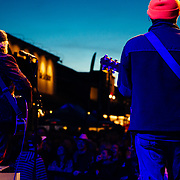 Robert Earl Keen performs to a packed crowd in Jackson, Wyoming. Behind the performance looking towards the crowd.
