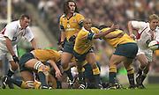 Twickenham, England, Autumn International. RFU Twickenham Stadium<br /> 16/11/2002<br /> International Rugby - England vs Australia.<br /> George Gregan moves the ball away.         [Mandatory Credit:Peter SPURRIER/Intersport Images]