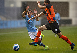 Manchester City U19's Ian Poveda battles for the ball with Shakhtar Donetsk's Roman Yakuba