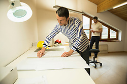 Architect working on blueprint in office, Bavaria, Germany