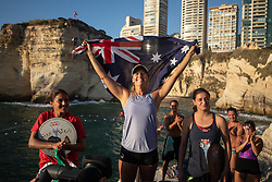 © Licensed to London News Pictures. 14/07/2019. Beirut, Lebanon. Australian cliff diver Rhiannan Iffland (centre) celebrates after she wins the the Women's Red Bull Cliff Diving elite competition on Raouche Rocks, Beirut, Lebanon. Beirut is the fifth location out of seven events on the world tour. Photo credit : Tom Nicholson/LNP