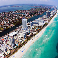 Clear view of barrier island Miami Beach and Atlantic Ocean, fisheye lens over hotel strip.