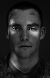 Cpl. Sean O'Rourke, 21, Eatonville, Washington. 2nd Platoon, Kilo Company, 3rd Battalion, 1st Marine Regiment, 1st Marine Division, United States Marine Corps, at the company's firm base in Hit, Iraq on Friday Sept. 23, 2005.