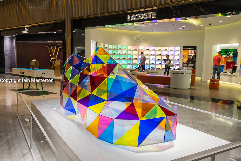 "Acrylic  sculpture of shoe ""Triangulated Sneaker "" at Level Shoe District in Dubai Mall United Arab Emirates"