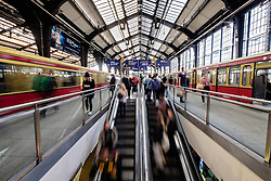 Blurred motion image of passengers on platforms at Friedrichstrasse railway station on the S-Bahn in Berlin Germany