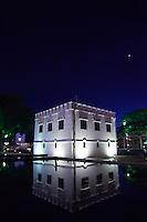 Historic buildings along Kuchings waterfront at night.