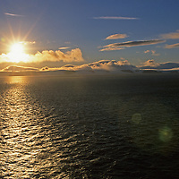 The sun sets over Northbrook Island, one of the southernmost points in Russia's Franz Josef archipeligo, Europe's northermost islands.