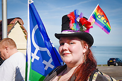 A participant sports stylish headwear during the Kent Pride celebrations in the seaside town of Margate.