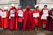 Women dressed as Handmaidens during a demonstration against U.S. President Donald Trumps state visit to the U.K on the 4th June 2019 in London in the United Kingdom. Day two of President Trumps three-day state visit, which includes lunch with the Queen, a State Banquet at Buckingham Palace as well as business meetings with the Prime Minister and the Duke of York, before travelling to Portsmouth to mark the 75th anniversary of the D-Day landings.