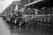 17/03/1963<br /> 03/17/1963<br /> 17 March 1963<br /> Tim Cunningham, Young Farmer of the Year from Co, Monaghan on a David Brown 880 tractor in the N.A.I.D.A. St. Patricks Day Parade, pulls a Macra float past the reviewing stand at the G.P.O. Dublin.