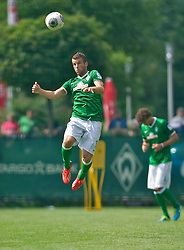 10.07.2013, Parkstadion, Zell am Ziller, AUT, SV Werder Bremen Trainingslager, im Bild Lukas Schmitz (Bremen #13) beim Kopfball during Trainingsession of German Bundesliga Club SV Werder Bremen at the Parkstadium, Zell am Ziller, Austria on 2013/07/10. EXPA Pictures © 2013, PhotoCredit: EXPA/ Andreas Gumz <br /> <br /> ***** ATTENTION - OUT OF GER *****