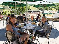 "Donna LaMarca, Jessica Durante and Keiley Durante enjoy a lunch at Gunstock Mountain's new ""Landing Zone"" outdoor patio dining.  (Karen Bobotas/for the Laconia Daily Sun)"