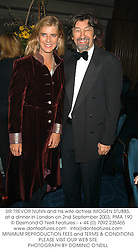SIR TREVOR NUNN and his wife actress IMOGEN STUBBS, at a dinner in London on 2nd September 2003.PMA 190