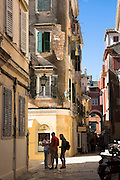 Group of tourists in street scene in Kerkyra, Corfu Town, Greece
