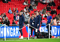 England's Harry Kane (left), Kieran Trippier, Jordan Pickford and Jordan Henderson on the pitch ahead of the FIFA World Cup Qualifying match at Wembley Stadium, London. Picture date: Tuesday October 12, 2021.