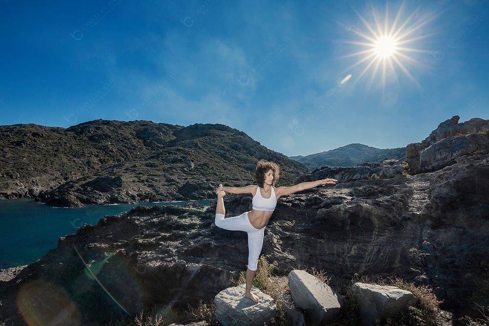 Woman doing yoga exercises in nature